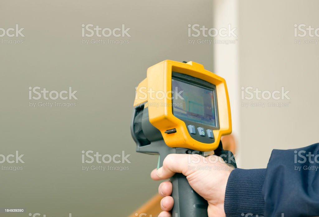 Infrared Thermal Imaging Camera for Home Energy Audit royalty-free stock photo