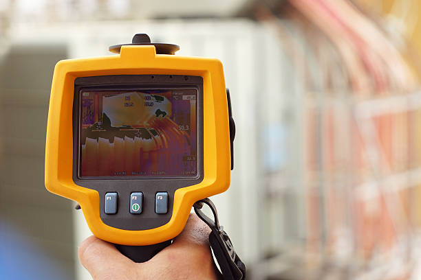 Infrared Thermal Imaging Camera Pointing to Electrical Transformer stock photo