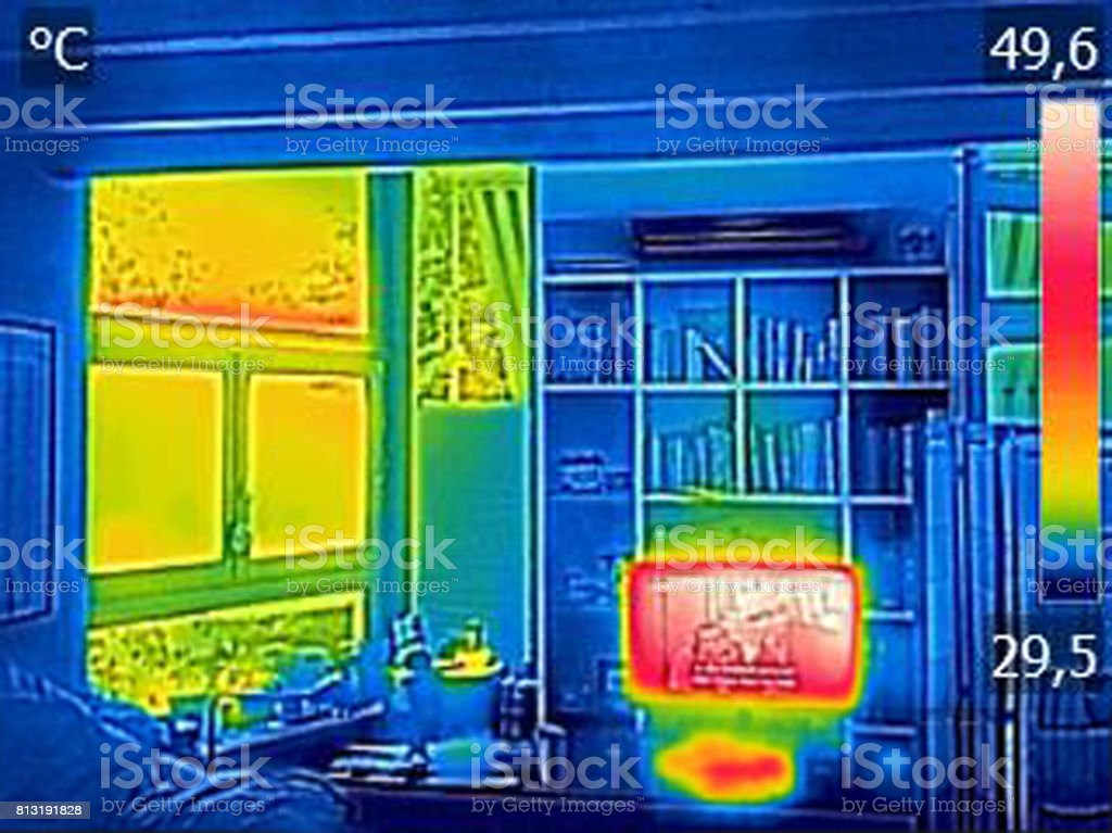 Infrared thermovision image showing heated TV and a window in the living room stock photo