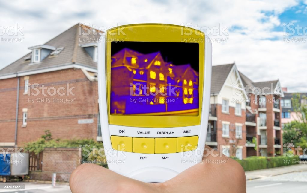Infrared thermovision image showing thermal insulation of house. stock photo