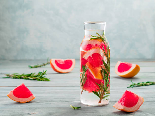 infused detox water with grapefruit and rosemary - grapefruit cocktail stock photos and pictures