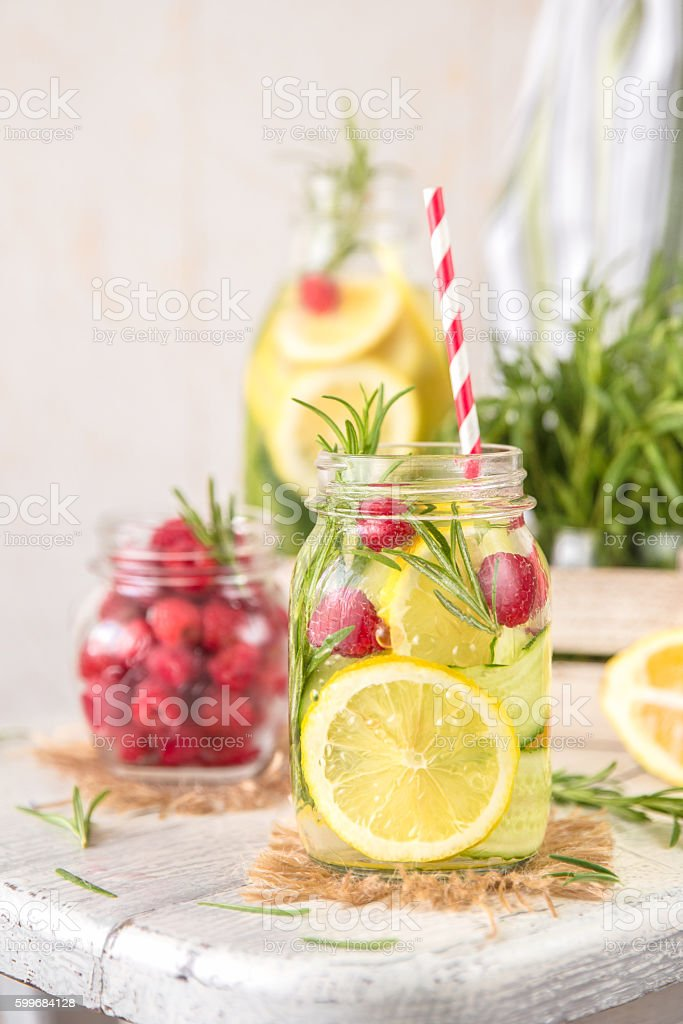 Infused Detox Water with lemon, cucumber, raspberry and rosemary stock photo