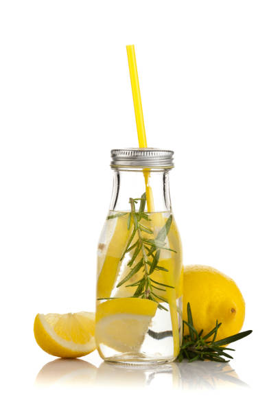 infused lemon water detox drink on white background - fruit juice bottle isolated foto e immagini stock