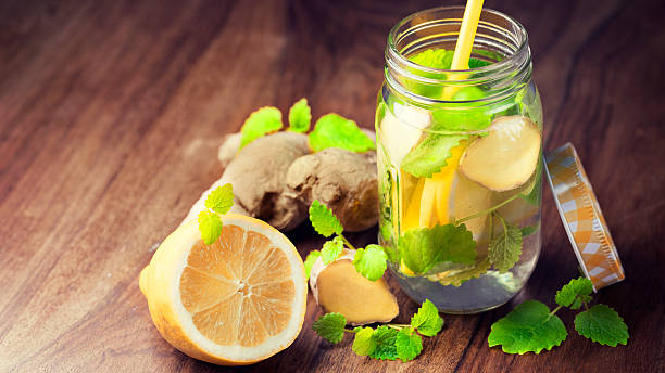 infused water for detoxing your body - ginger stock photos and pictures