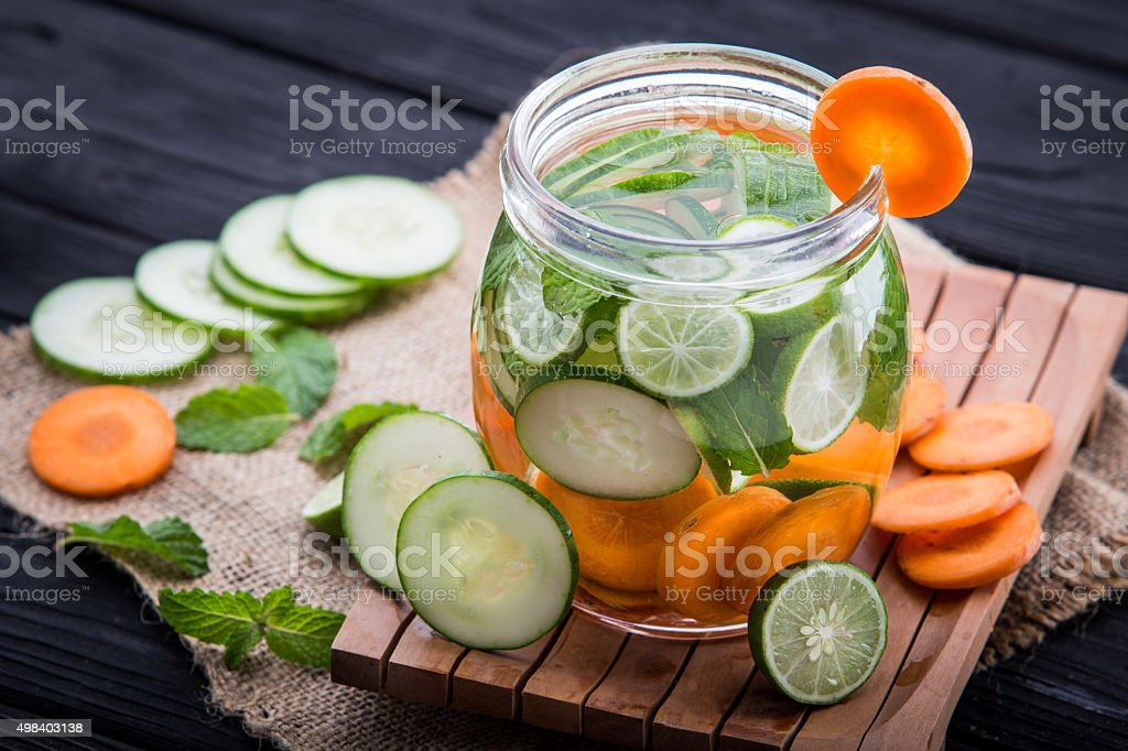 infused water mix of  cucumber, carrot, and lime royalty-free stock photo