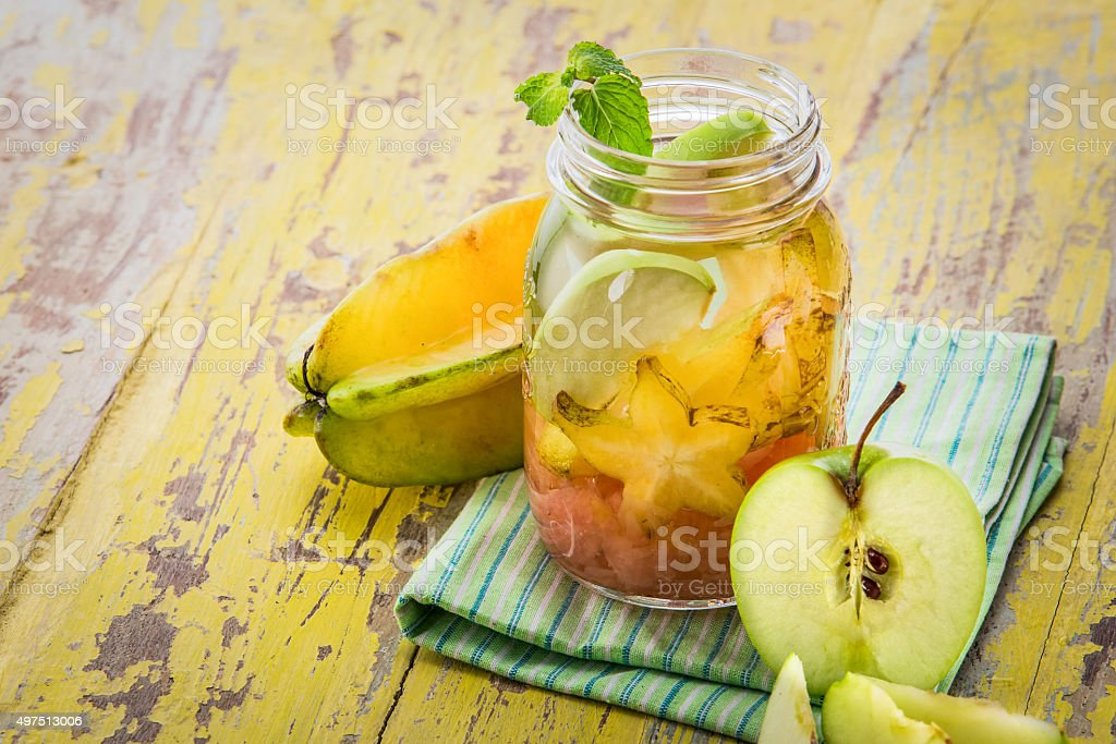 infused water mix of starfruit, grapefruit, and apple stock photo