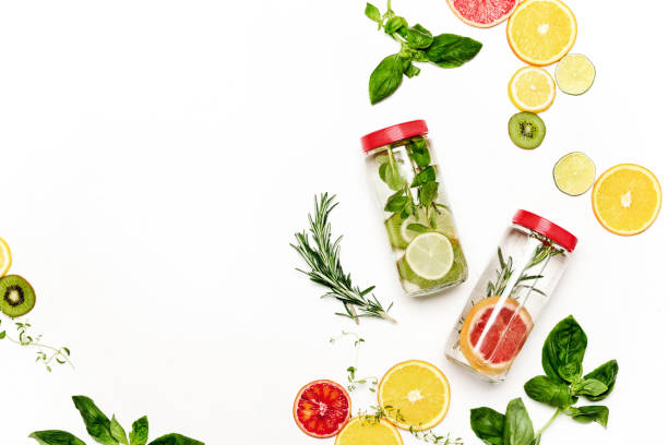 Infused waters with various ingredients background Infused water in bottles with various ingredients such as culinary aromatic herbs and fruits, healthy lifestyle concept, overhead view, blank space for a text infused stock pictures, royalty-free photos & images