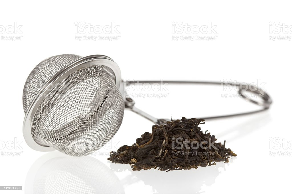 Infuser with Green Tea leaves royalty-free stock photo