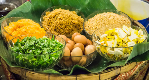 Ingredient egg, coriander leaves, bean curd, groundnut peanut, Chinese salted radish in bowl for cooking Thai food style stock photo