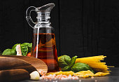 Ingredient for cooking Italian pasta on wooden dark background with copy space