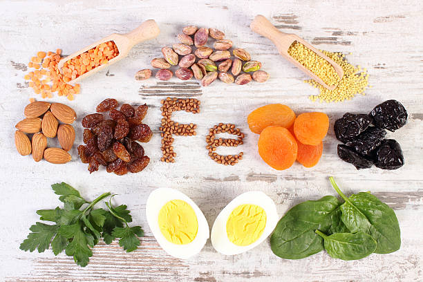 Ingredients and products containing iron and dietary fiber, healthy nutrition Inscription Fe, ingredients or product containing iron and dietary fiber, natural sources of ferrum, healthy lifestyle, food and nutrition anemia stock pictures, royalty-free photos & images