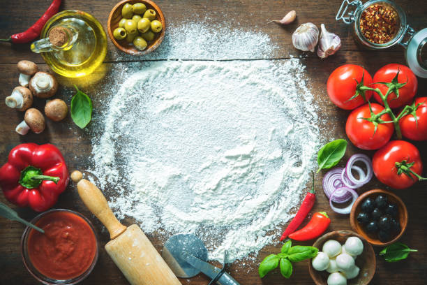 ingredients and spices for making homemade pizza - italian food stock photos and pictures