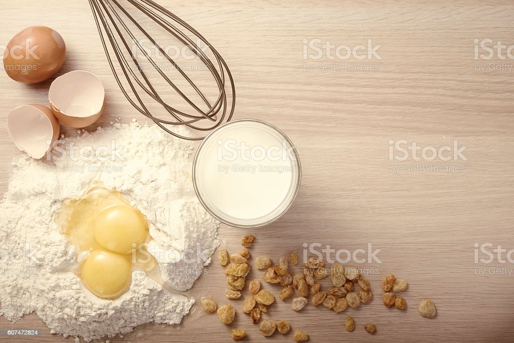 Ingredients and tools to make a cake stock photo