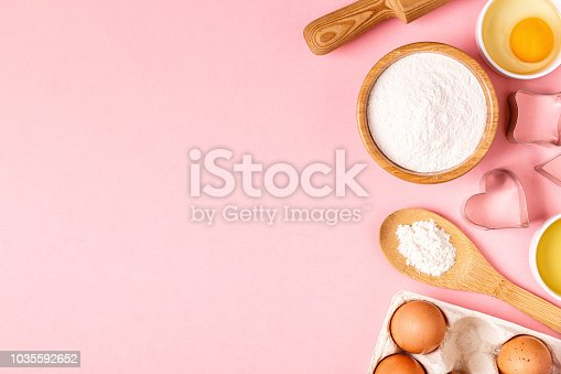 Ingredients and utensils for baking on a pastel background, top view.