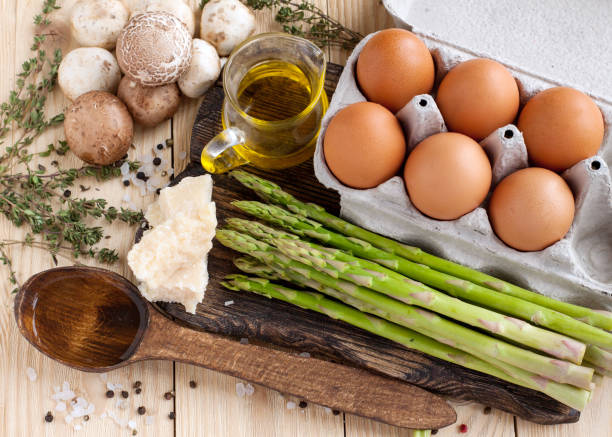 Ingredients for asparagus and mushroom frittata stock photo