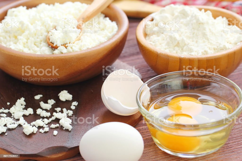 Ingredients for baking : cottage cheese, eggs and flour royalty-free stock photo