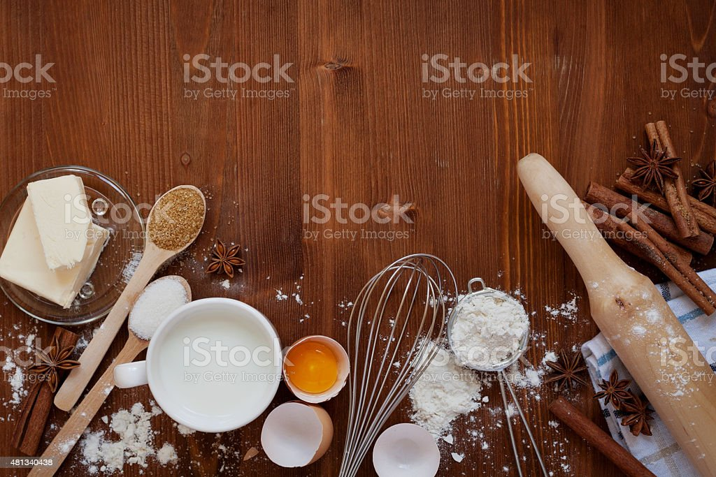 Ingredients for baking flour, eggs, milk, butter, sugar, cinnamon, anise stock photo