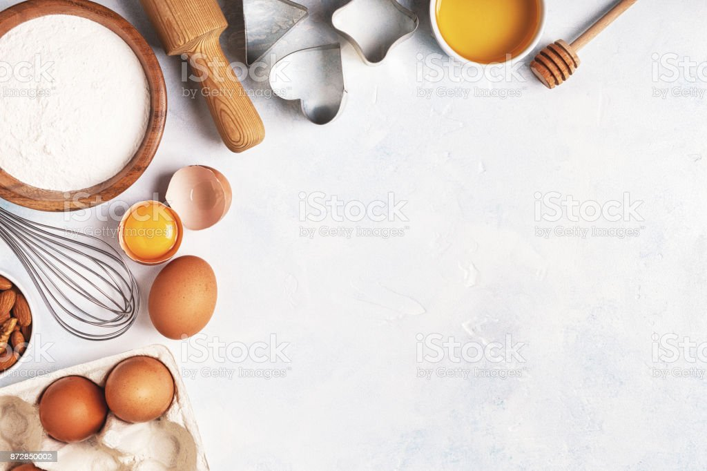 Ingredients for baking  - flour, wooden spoon, rolling pin, eggs. stock photo
