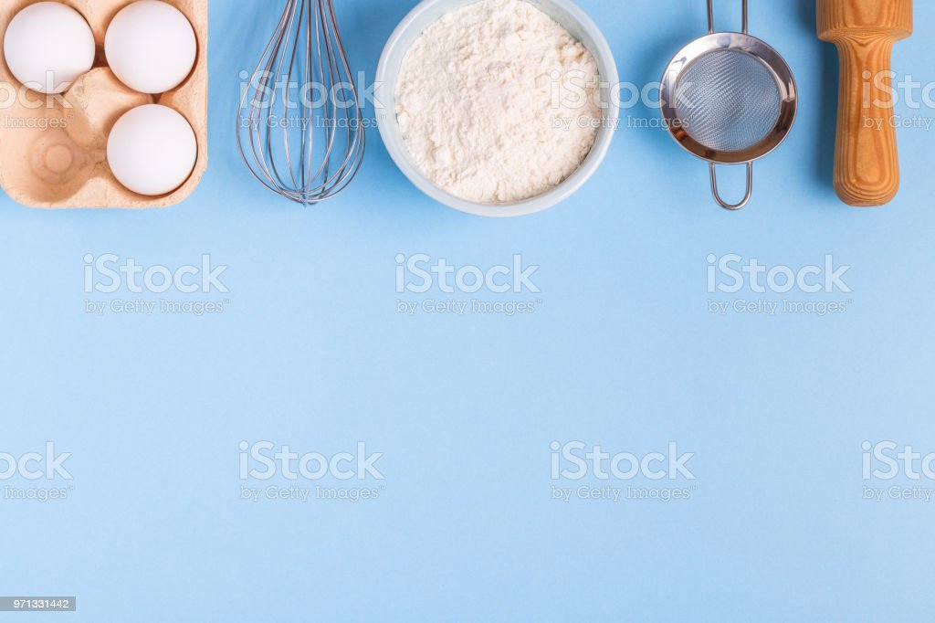 Ingredients for baking  on a blue background. stock photo