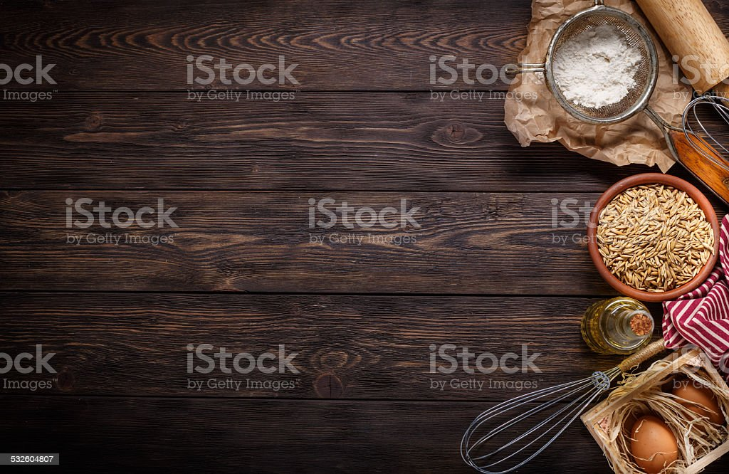 Ingredients for baking on empty dark wooden background with plac stock photo