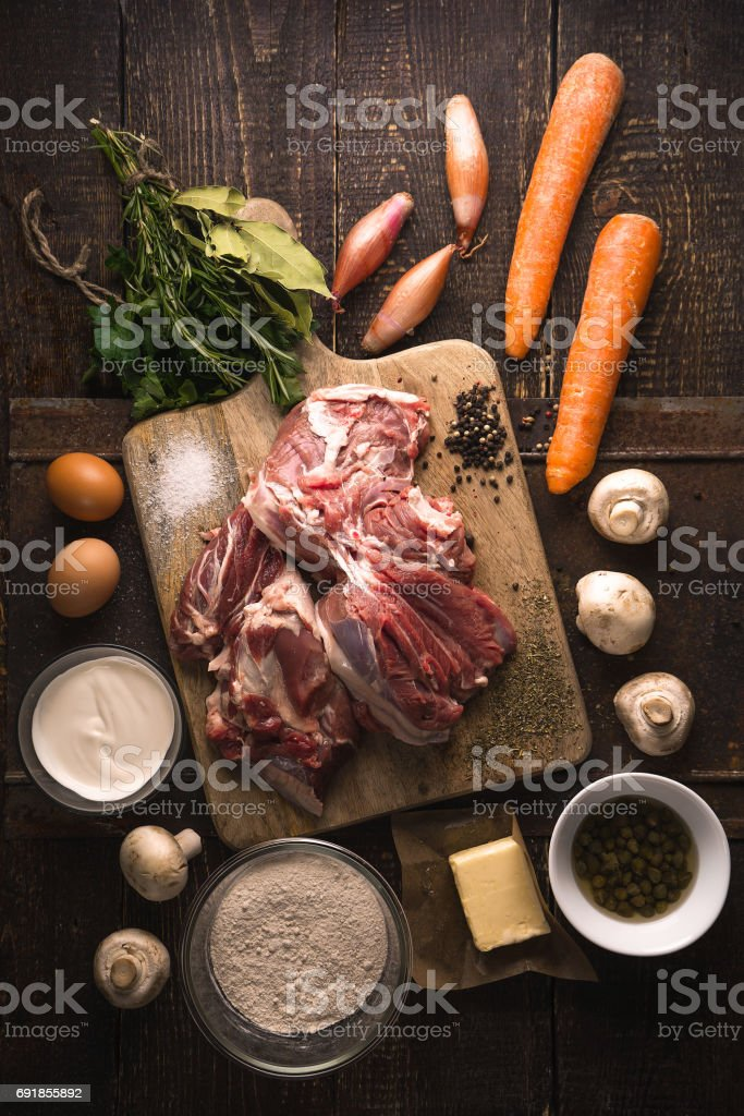 Ingredients for blanquette on the wooden table vertical stock photo