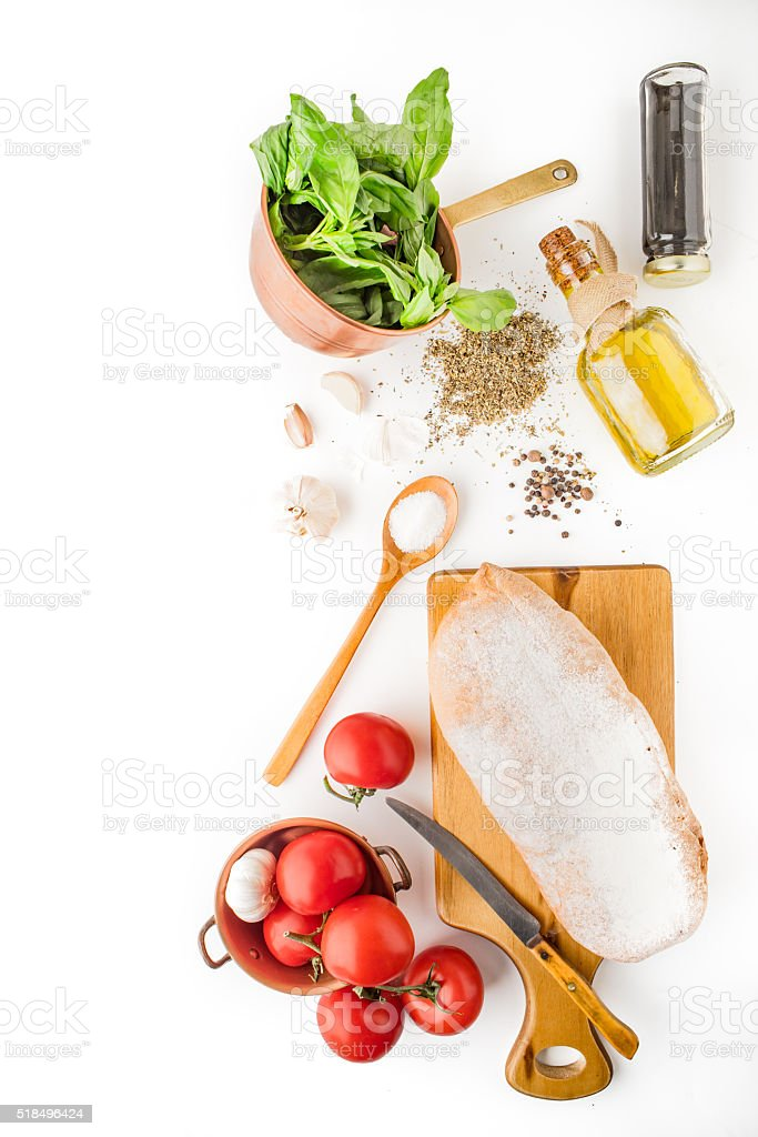 Ingredients for  bruschetta on the white background vertical stock photo