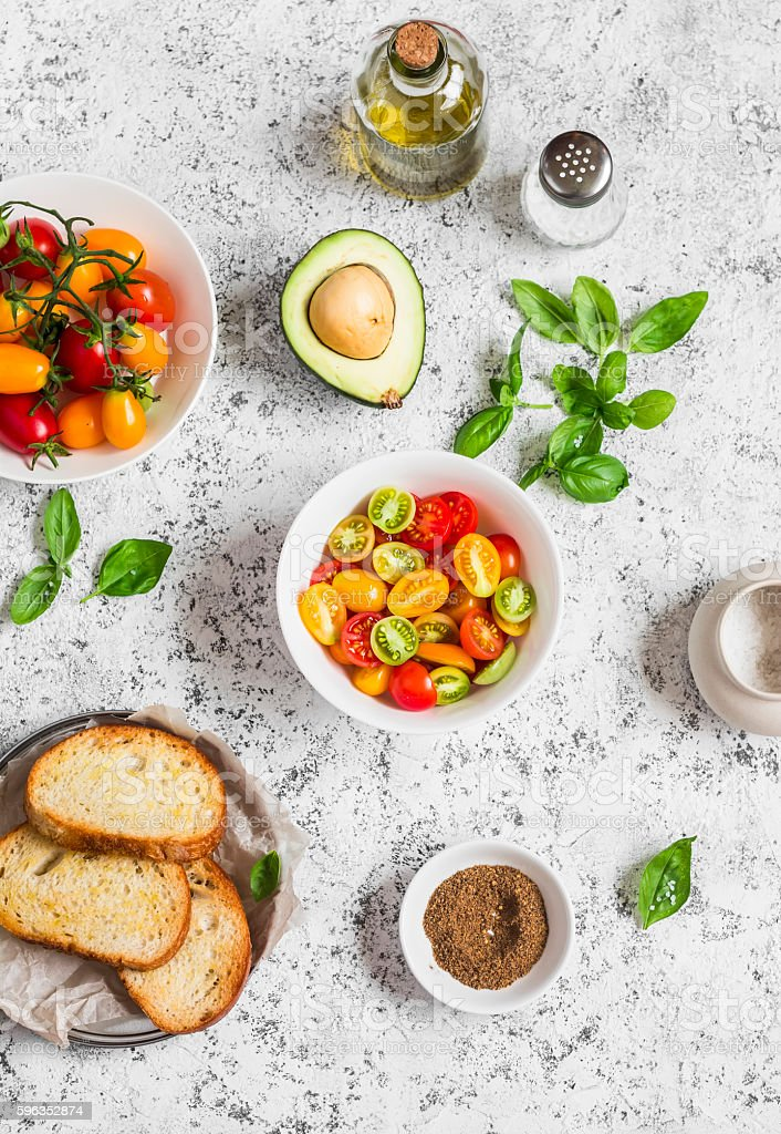 Ingredients for bruschetta - tomatoes, avocado, basil, olive oil, bread royalty-free stock photo