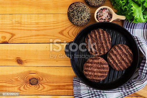 1134487598 istock photo Ingredients for burger. Beef meat cooked on the grill 923099520