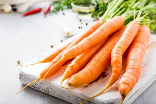 ingredients for carrot soup - cenoura imagens e fotografias de stock