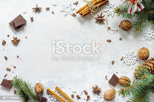 istock Ingredients for Christmas baking - chocolate, cinnamon, anise and nuts on a stone or slate background. Seasonal, food background. 857156360