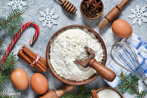 istock Ingredients for Christmas baking: flour, eggs, sugar, nuts, cinnamon, spices. Top view. 1174864172