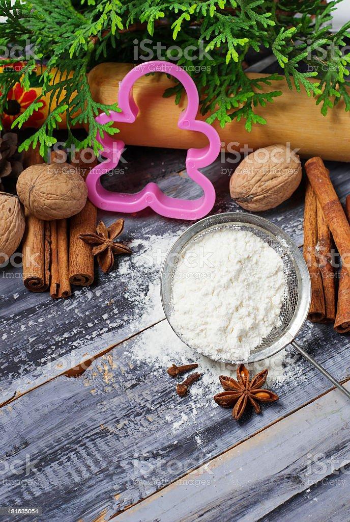 Ingredients for Christmas cookies -  flour, anise, cinnamon stock photo