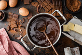 Top View of the process of cooking chocolate bakery pastry with melting chocolate. Ingredients for cooking chocolate