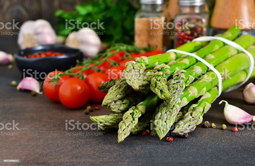 Ingredients for cooking. Fresh vegetables: asparagus, tomatoes, garlic and spices. Organic food. royalty-free stock photo
