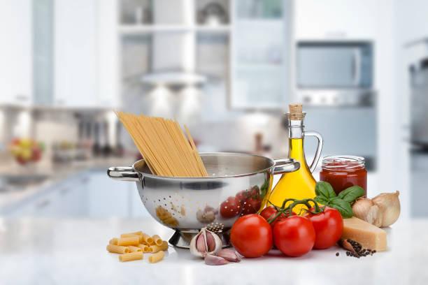 Ingredients for cooking italian pasta shot on kitchen counter picture id975738634?b=1&k=6&m=975738634&s=612x612&w=0&h=jlmtq odul66eynga1fqrqxj8zkbkfdvrlwnipnzohc=
