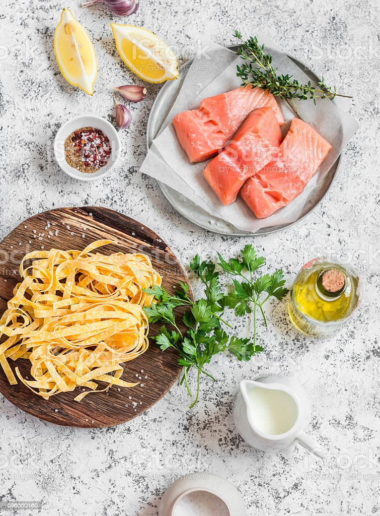 Ingredients for cooking lunch - salmon, pasta, cream, olive oil royalty-free stock photo