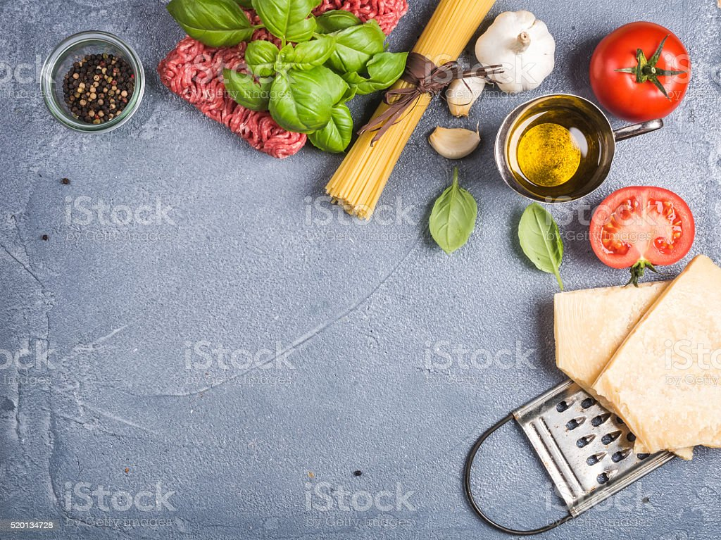 Ingredients for cooking pasta Bolognese. Spaghetti, Parmesan cheese,  tomatoes, metal stock photo