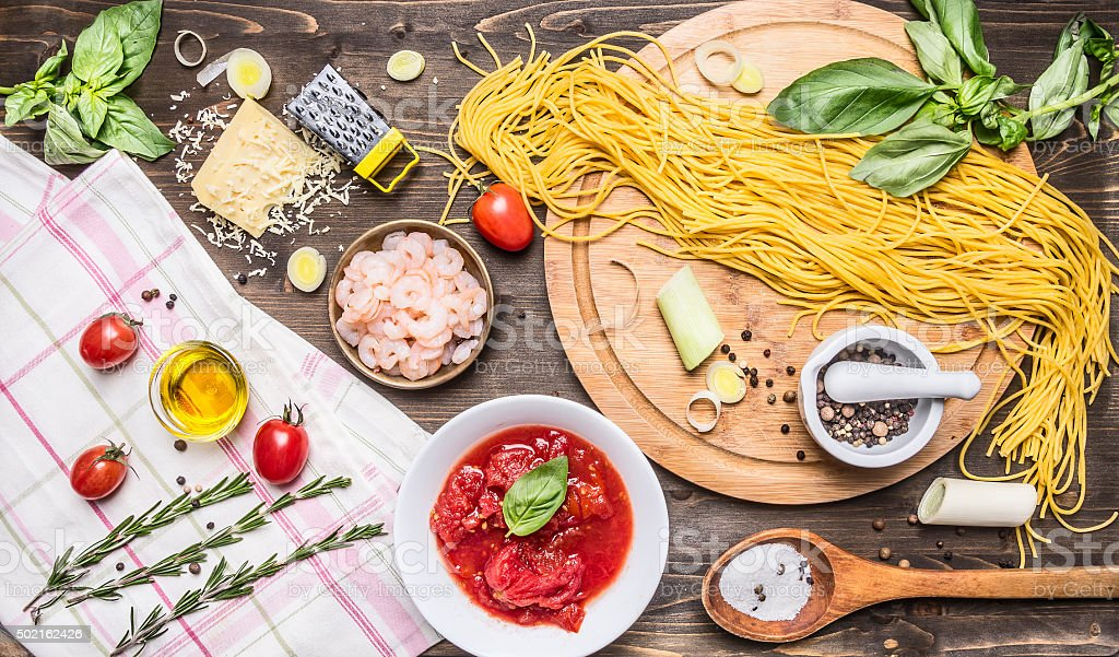 Ingredients for cooking pasta, on wooden rustic background top view stock photo