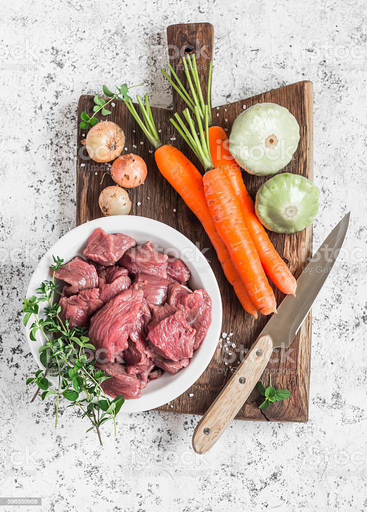 Ingredients for cooking  - raw beef, carrots, squashes, onions, spices Lizenzfreies stock-foto
