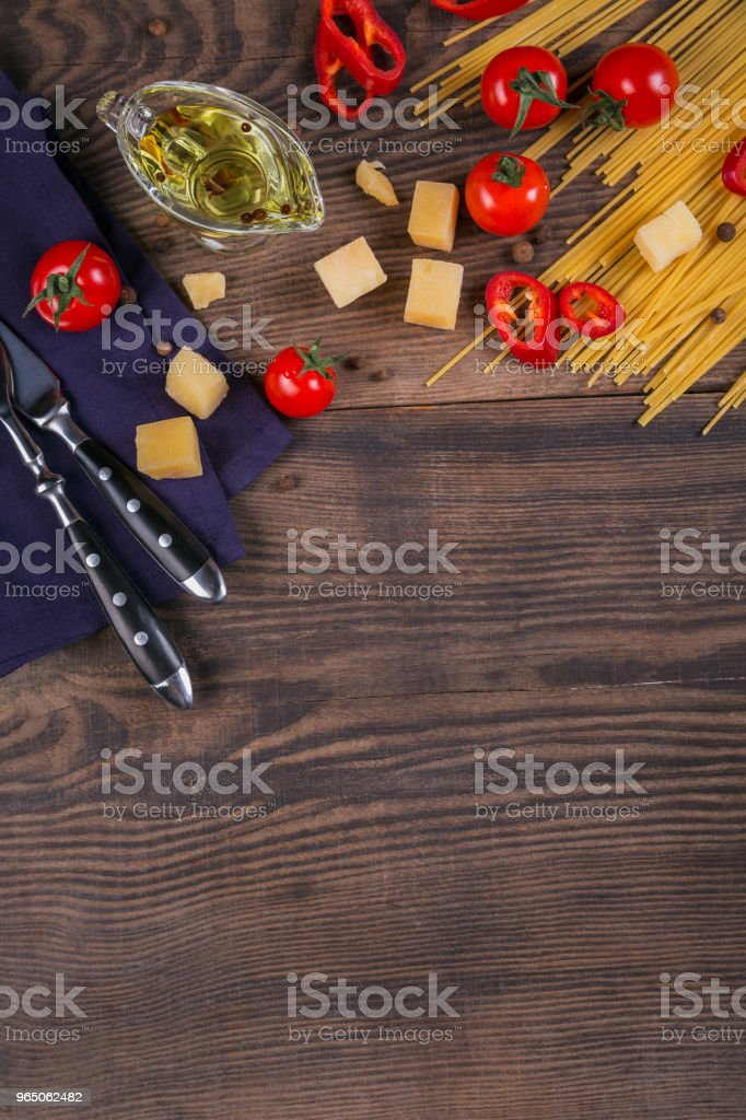 Ingredients for cooking spaghetti - raw pasta, tomato, olive oil, spices, herbs royalty-free stock photo