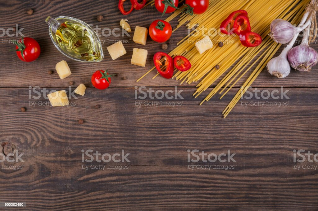 Ingredients for cooking spaghetti - raw pasta, tomato, olive oil, spices, herbs zbiór zdjęć royalty-free