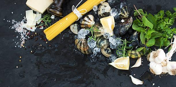 ingredients for cooking spaghetti vongole. clams on chipped ice, raw - pasta vongole bildbanksfoton och bilder