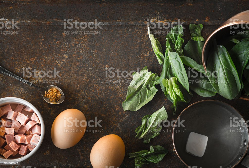 Ingredients for Florentine eggs  on rusty background top view stock photo