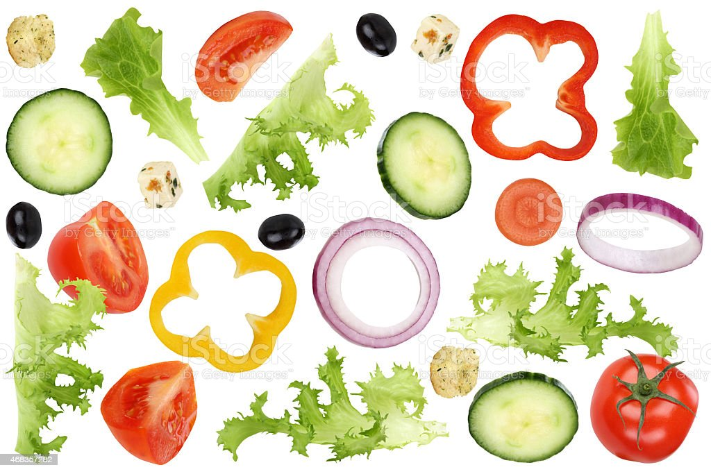 Ingredients for flying salad with tomatoes, lettuce, onion, olives, cucumber royalty-free stock photo