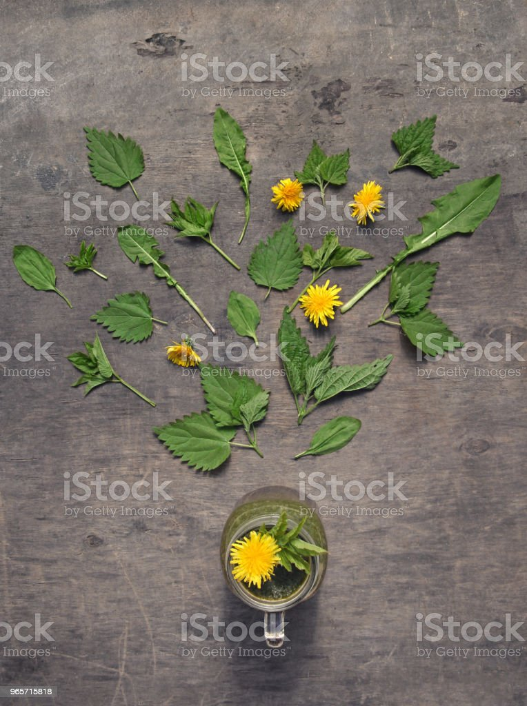Ingredients for fresh green smoothie (nettle, dandelion, goutweed, plantain) on rustic wooden background. Vegan. Organic. Healthy - Royalty-free Blended Drink Stock Photo