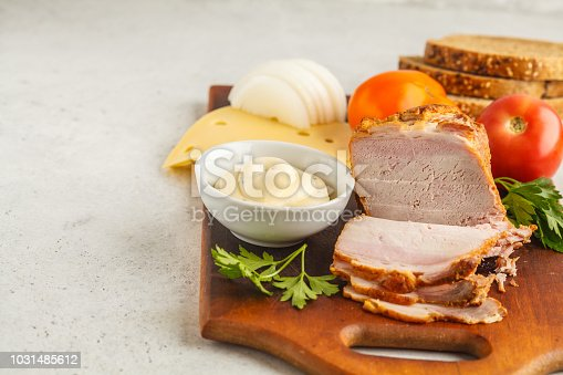 Ingredients for ham and cheese sandwiches on wooden board, white background, copy space.