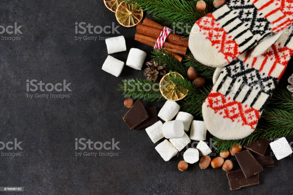 Ingredients for hot chocolate on a black background. Warm winter drink. Happy New Year and Merry Christmas. stock photo