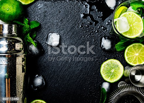 istock Ingredients for making alcoholic summer cocktail and bar tools 693113480