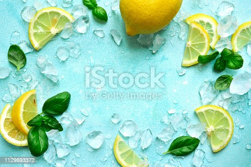 Ingredients for making homemade summer lemonade or cocktail on a light blue slate, stone or concrete background.Top view with copy space.