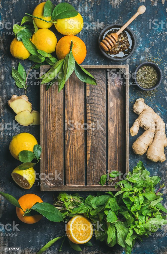Ingredients for making natural drink with wooden tray in center stock photo